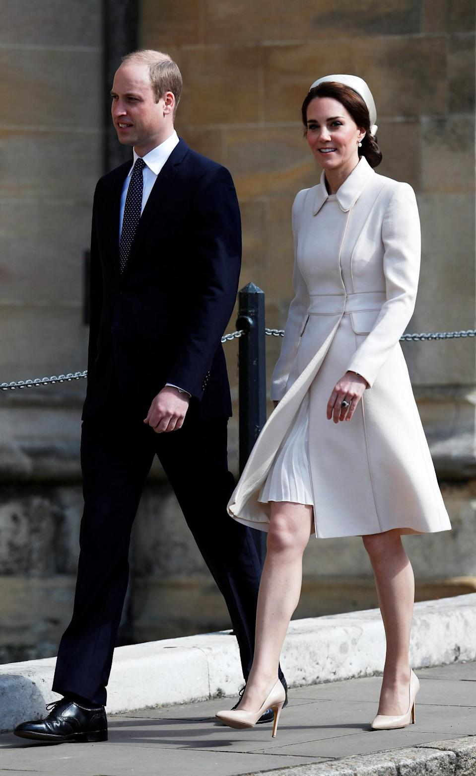 <p>Kate recycled yet another outfit for the Easter Sunday service in Windsor. Her bespoke cream coat by Catherine Walker was first seen on the Canadian royal tour. The Duchess chose matching accessories in the form of Rupert Sanderson pumps and a lattice clutch by Etui Bags. A satin pillbox hat topped off the springtime look.<br><i>[Photo: PA]</i> </p>