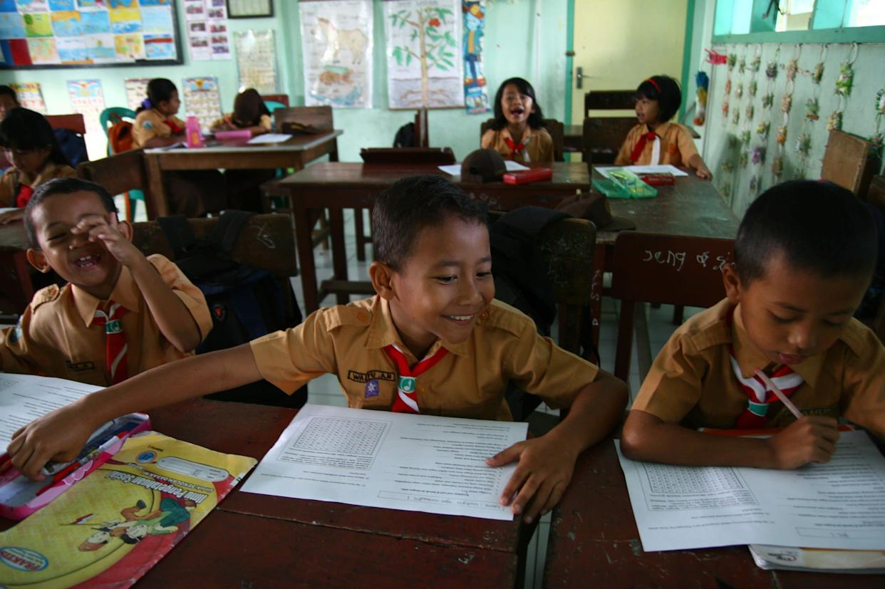 Indonesian student Wahyu (center), 8, during class on May 31, 2013.