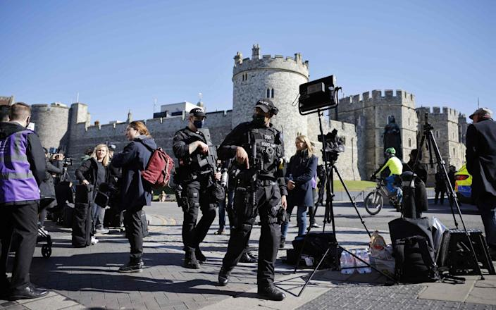 Police officers on patrol outside Windsor Castle ahead of the funeral service this afternoon - Toga Akmen/AFP
