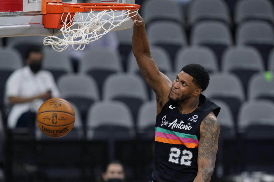San Antonio Spurs forward Rudy Gay (22) scores against the Orlando Magic during the second half of an NBA basketball game in San Antonio, Friday, March 12, 2021. (AP Photo/Eric Gay)