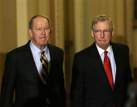 Senate Minority Leader Mitch McConnell (R-KY) (R) and Senator Lamar Alexander (R-TN) (L) walk to a press conference on Capitol Hill in Washington November 21, 2013. REUTERS/Gary Cameron