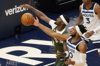 Minnesota Timberwolves' Josh Okogie, right, breaks up a shot attempt by Milwaukee Bucks' Bobby Portis in the first half of an NBA basketball game Wednesday, April 14, 2021, in Minneapolis. (AP Photo/Jim Mone)
