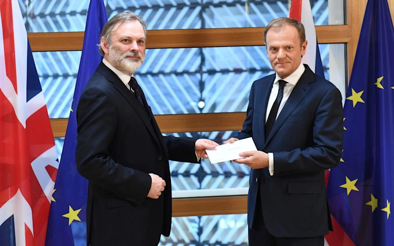 Britain's ambassador to the EU Tim Barrow delivers British Prime Minister Theresa May's formal notice of the UK's intention to leave the bloc under Article 50 of the EU's Lisbon Treaty to European Council President Donald Tusk in Brussels. - AFP