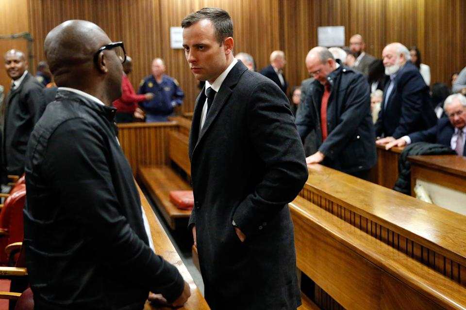 South African Paralympian athlete Oscar Pistorius (C) speaks to a man at the High Court in Pretoria, on July 6, 2016 after being sentenced to six years in jail for murdering his girlfriend Reeva Steenkamp three years ago. Pistorius was freed from prison in the South African capital Pretoria last October after serving one year of a five-year term for culpable homicide -- the equivalent of manslaughter. / AFP PHOTO / POOL / MARCO LONGARI (Photo by Xinhua/Sipa USA)
