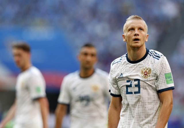 Russia's Igor Smolnikov leaves the pitch after receiving the red card during the group A match between Uruguay and Russia at the 2018 soccer World Cup at the Samara Arena in Samara, Russia, Monday, June 25, 2018. (AP Photo/Rebecca Blackwell)
