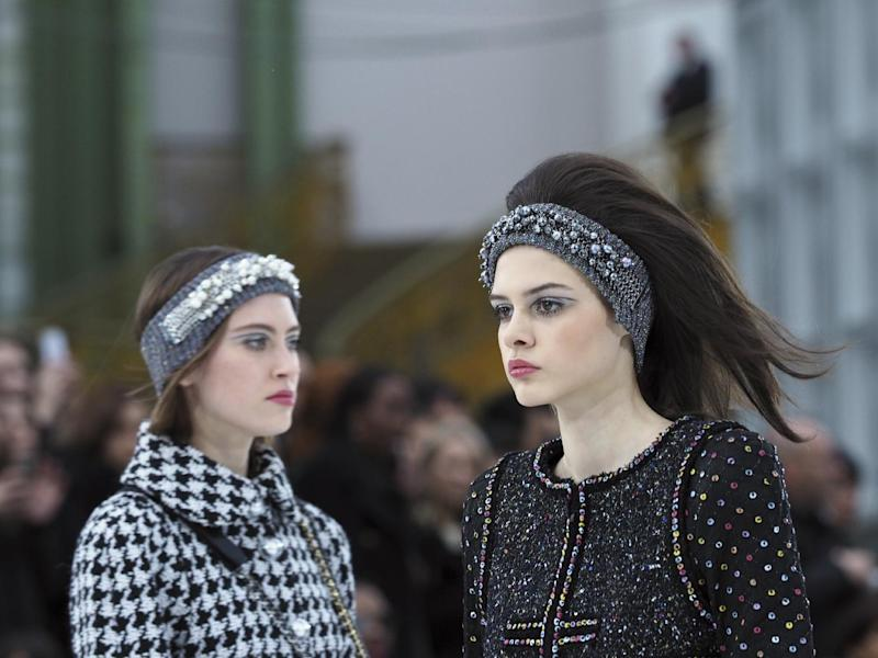 Models wear creations for Chanel's Fall-Winter 2017/2018 ready-to-wear fashion collection, Tuesday, March 7, 2017 in Paris. (AP Photo/Thibault Camus)