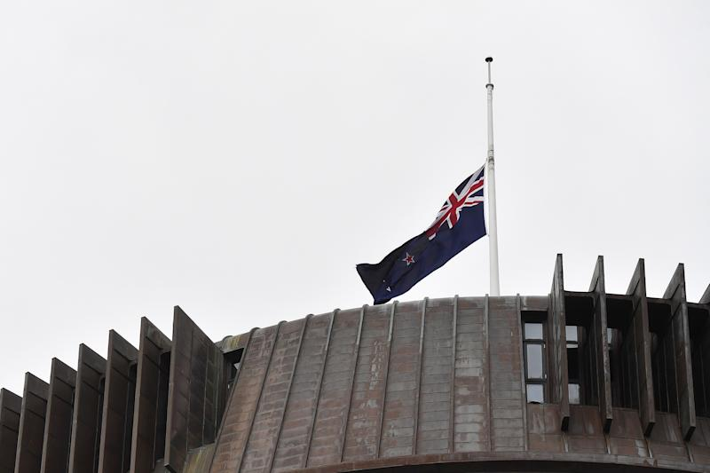 WELLINGTON, NEW ZEALAND - MARCH 16: New Zealand flag flies at half mast on the roof of the Beehive on March 16, 2019 in Wellington, New Zealand. At least 49 people are confirmed dead, with more than 40 people injured following attacks on two mosques in Christchurch on Friday afternoon. (Photo by Mark Tantrum/Getty Images) ORG XMIT: 775316174 ORIG FILE ID: 1136042627
