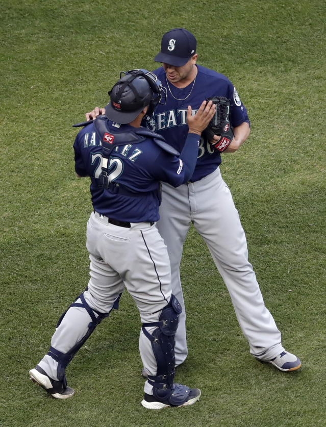 Seattle Mariners relief pitcher Anthony Swarzak, right, celebrates with catcher Omar Narvaez after they defeated the Chicago White Sox in Chicago, Sunday, April 7, 2019. (AP Photo/Nam Y. Huh)