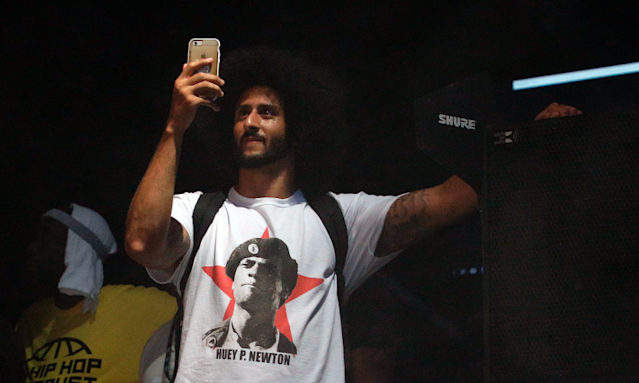 Colin Kaepernick wears a T-shirt depicting the late Huey Newton, co-founder of the Black Panthers and a proponent of African-American militancy in the 1960s. (Getty)