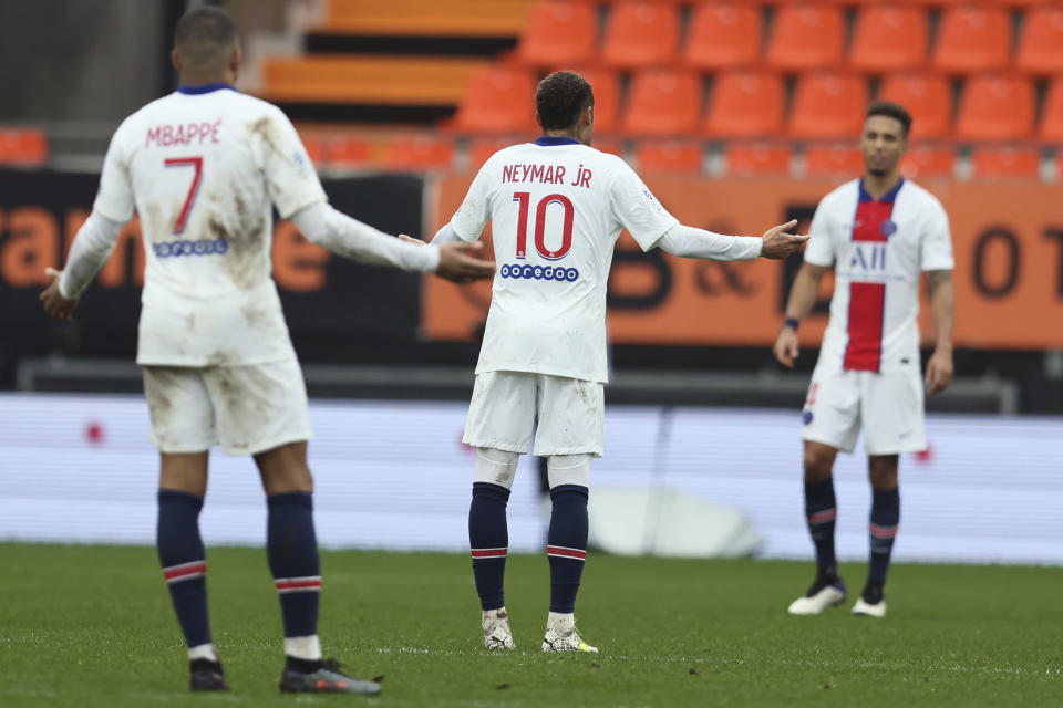 PSG's Neymar, center, and Kylian Mbappe react after being defeated by FC Lorient during the French League One soccer match between FC Lorient and Paris Saint-Germain at the Moustoir stadium in Lorient, western France, Sunday, Jan. 31, 2021. (AP Photo/David Vincent)