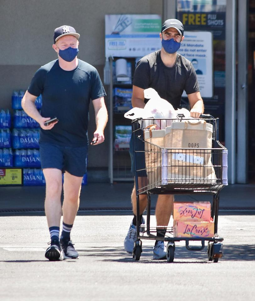 <p>Jesse Tyler Ferguson and Justin Mikita sport coordinated looks while shopping in L.A. on Saturday.</p>