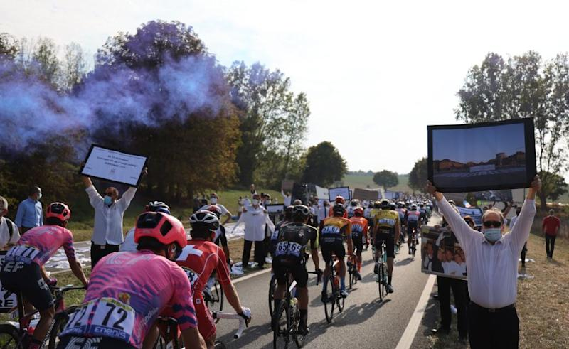 Catering freelancers stage a protest during the 21st and last stage of the 107th edition of the Tour de France cycling race 122 km between ManteslaJolie and Champs Elysees Paris on September 20 2020 Photo by Kenzo Tribouillard AFP Photo by KENZO TRIBOUILLARDAFP via Getty Images