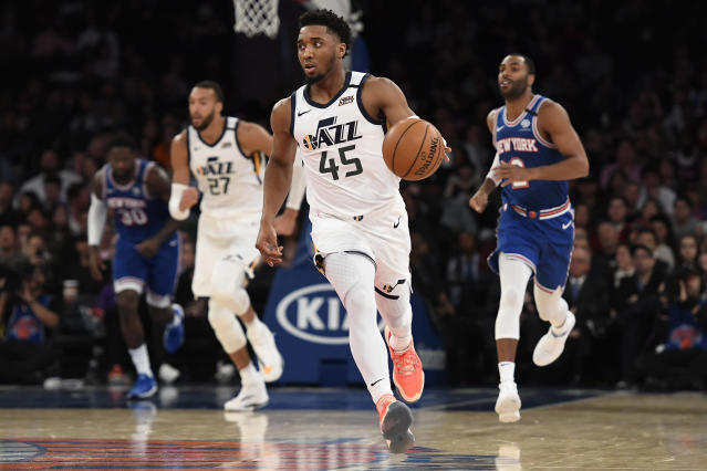 Utah Jazz guard Donovan Mitchell (45) brings the ball up during the second half of the team's NBA basketball game against the New York Knicks in New York, Wednesday, March 4, 2020. (AP Photo/Sarah Stier)