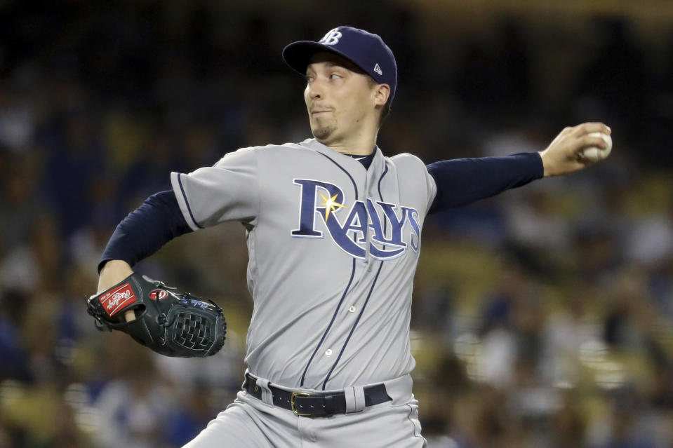 FILE - In this Sept. 17, 2019, file photo, Tampa Bay Rays starting pitcher Blake Snell throws to a Los Angeles Dodgers batter during the first inning of a baseball game in Los Angeles. Rays All-Star pitcher Blake Snell says he will not take the mound this year if his pay is cut further, proclaiming: Im not playing unless I get mine. the 2018 AL Cy Young Award winner said on a Twitch stream Wednesday, May 14 2020. (AP Photo/Chris Carlson, File)