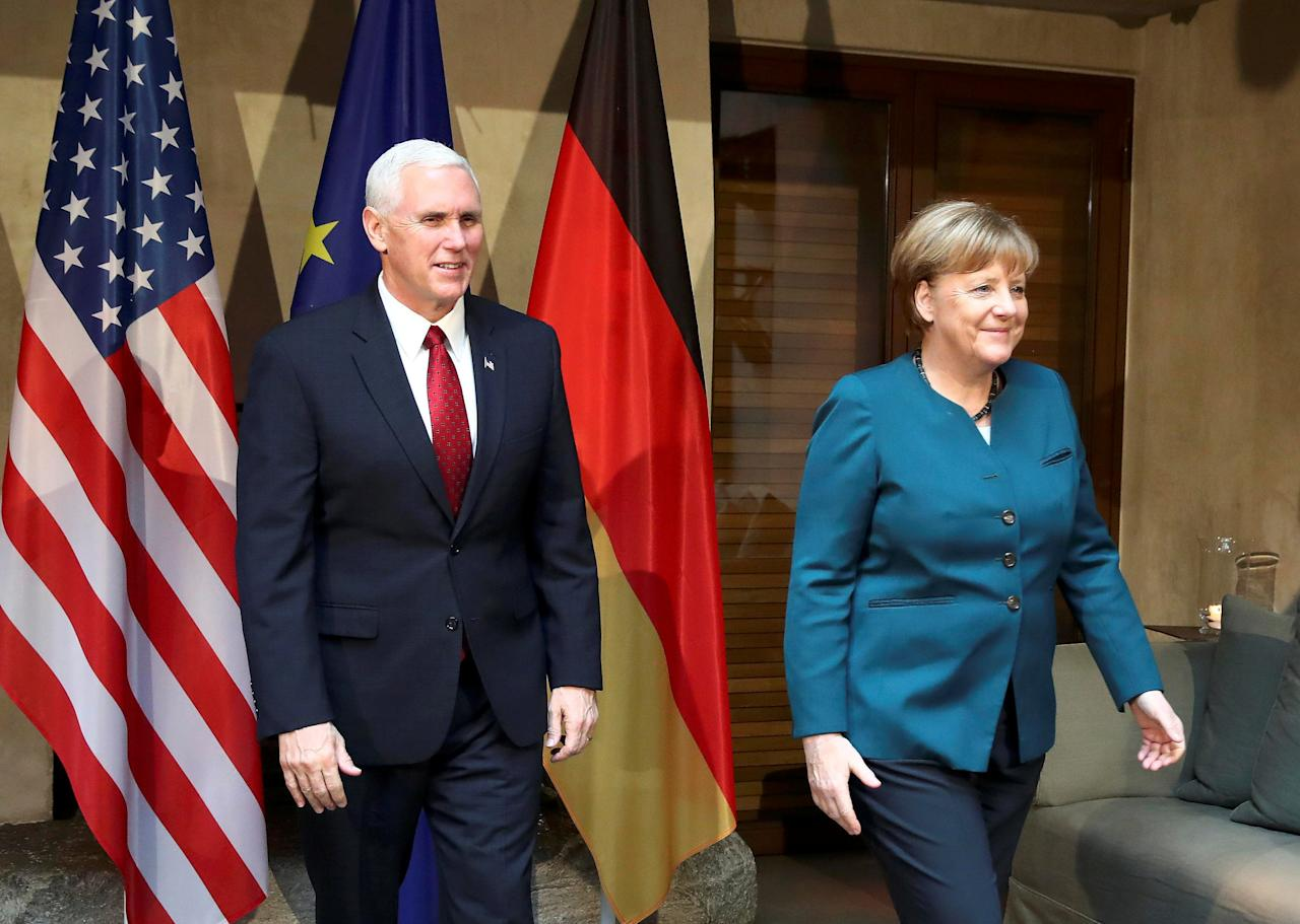 German Chancellor Angela Merkel walks with U.S. Vice President Mike Pence before their meeting at the 53rd Munich Security Conference in Munich, Germany, February 18, 2017.   REUTERS/Michael Dalder      TPX IMAGES OF THE DAY