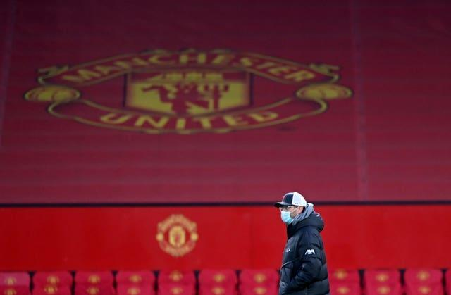 Liverpool manager Jurgen Klopp in front of the Manchester United crest at Old Trafford