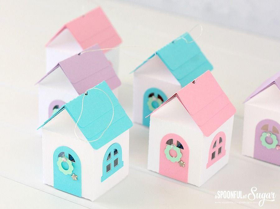 """<p>A machine, like the Cricut, makes quick work of cutting out all the shapes needed for these 3D ornaments, but you could just as easily paint mini bird houses for a similar effect. </p><p><em>Get the tutorial at <a href=""""http://aspoonfulofsugardesigns.com/2014/11/3d-christmas-house-ornaments/"""" rel=""""nofollow noopener"""" target=""""_blank"""" data-ylk=""""slk:Spoonful of Sugar Designs"""" class=""""link rapid-noclick-resp"""">Spoonful of Sugar Designs</a>. </em></p><p><a class=""""link rapid-noclick-resp"""" href=""""https://www.amazon.com/Creative-Hobbies-Birdhouse-Unfinished-Decorate/dp/B01CK8S4RK?tag=syn-yahoo-20&ascsubtag=%5Bartid%7C10072.g.34443405%5Bsrc%7Cyahoo-us"""" rel=""""nofollow noopener"""" target=""""_blank"""" data-ylk=""""slk:SHOP MINI WOODEN HOUSES"""">SHOP MINI WOODEN HOUSES</a></p>"""