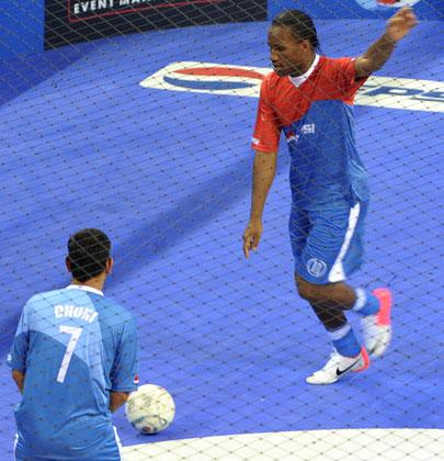 International football player from the Ivory Coast, Didier Drogba, prepares to kick the ball during an exhibition match in New Delhi on June 17, 2012. Drogba is in the city for the grand finale of the Pepsi T20 football tournament.  AFP PHOTO/ SAJJAD HUSSAIN