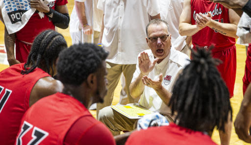 Jacksonville State head coach Ray Harper talks with his team during a time out in the first half of an NCAA college basketball game against Chicago State at the Emerald Coast Classic in Niceville, Fla., Friday, Nov. 29, 2019. (AP Photo/Mark Wallheiser)