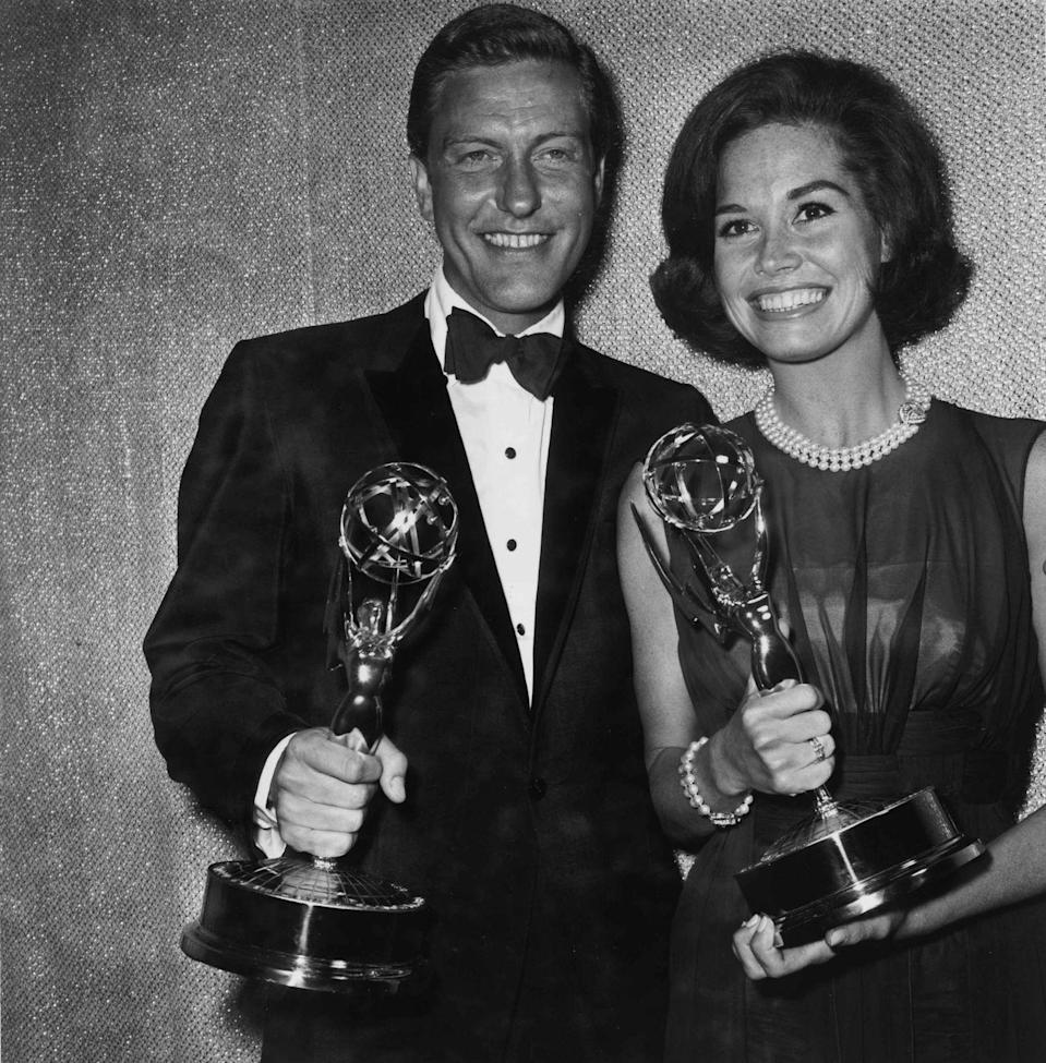 <p>Dick Van Dyke and Mary Tyler Moore smile while holding the Emmy Award they won for Best Actor and Best Actress for the television series, <em>Dick Van Dyke Show.</em></p>