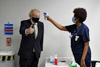 Prime Minister Boris Johnson (L) promised more resources for the health service after himself contracting Covid-19