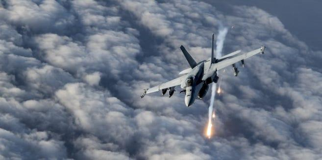 A U.S. Navy F/A-18E Super Hornet releases flares over Afghanistan, Jan. 23, 2020