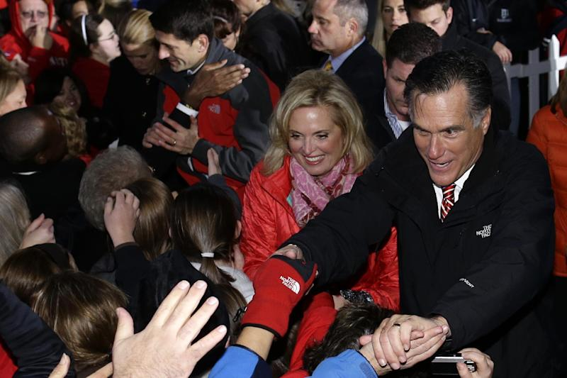 Republican presidential candidate, former Massachusetts Gov. Mitt Romney, his wife Ann Romney, Republican vice presidential candidate Rep. Paul Ryan, R-Wis., and his wife Janna Ryan, greet supporters at a campaign stop at The Square at Union Centre in West Chester, Ohio, Friday, Nov. 2, 2012. (AP Photo/Charles Dharapak)