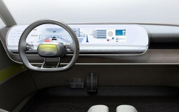 Inside it is minimalistic with mostly wood, fabric and leather. The interior of future cars would be heavy on tech and devoid of button clutter.