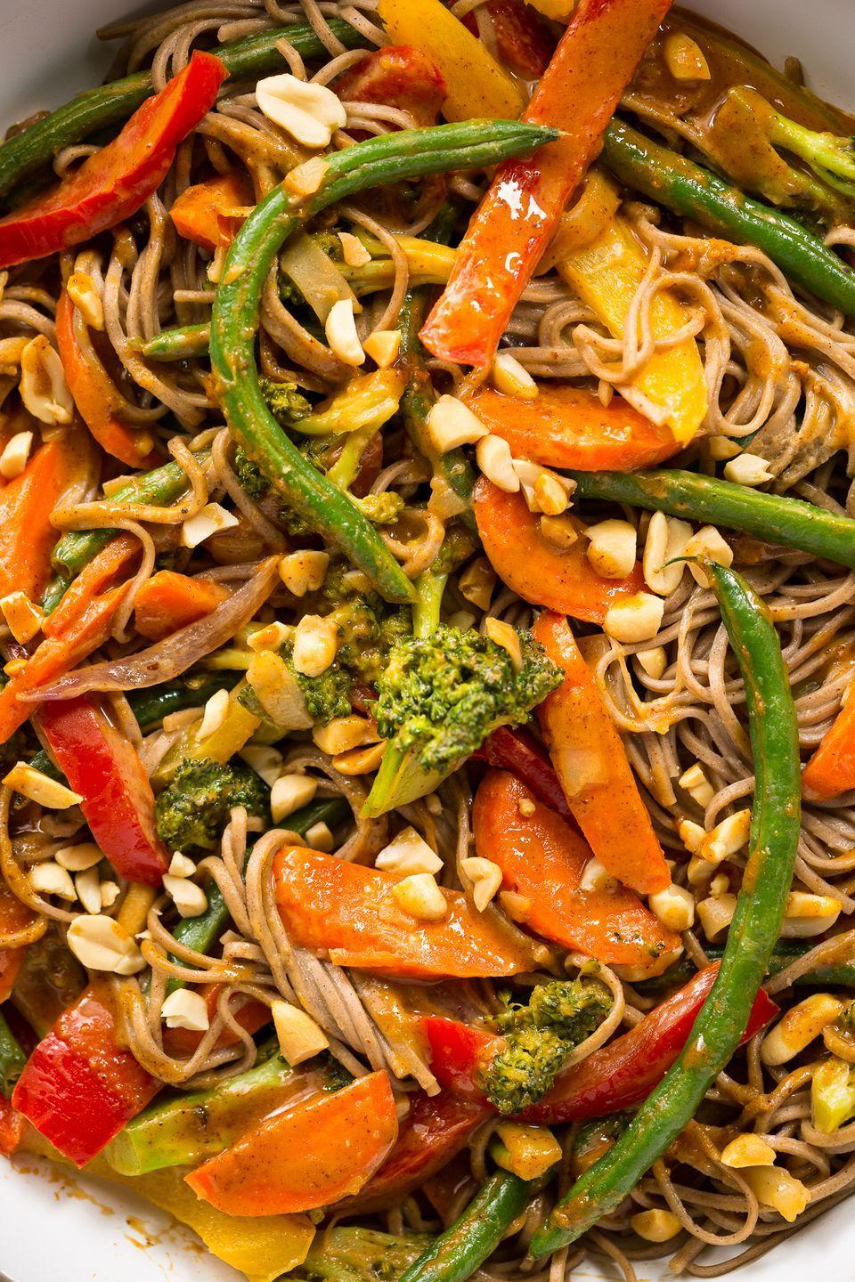 """<p>We're going (pea)NUTS for this Thai-inspired sauce.</p><p>Get the recipe from <a href=""""https://www.delish.com/cooking/recipe-ideas/recipes/a46829/rainbow-stir-fry-recipe/"""" rel=""""nofollow noopener"""" target=""""_blank"""" data-ylk=""""slk:Delish"""" class=""""link rapid-noclick-resp"""">Delish</a>. </p>"""