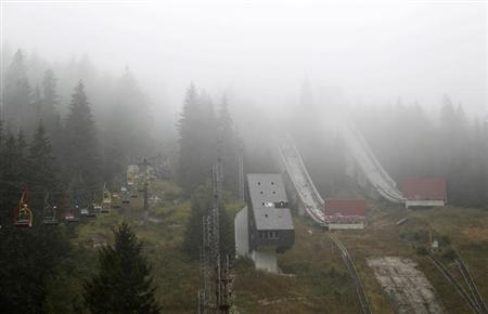 A general view of the disused ski jump from the Sarajevo 1984 Winter Olympics shrouded in mist on Mount Igman, near Saravejo September 19, 2013. REUTERS/Dado Ruvic/Files
