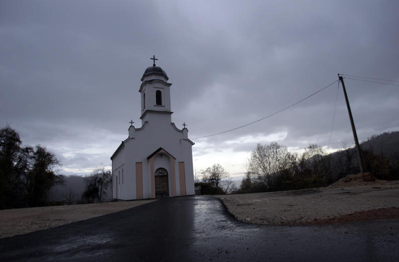 In this Nov. 30, 2012 photo is a church seen at twilight in the village of Zarozje, near the Serbian town of Bajina Basta. Get your garlic, wooden crosses and stakes ready: a bloodsucking vampire is on the loose. Or so say villagers in the tiny western Serbian hamlet of Zarozje, nestled between the lush green mountain slopes and spooky thick forests. Rumors that a legendary vampire ghost has returned are spreading panic throughout the town. An official warning telling villagers to put garlic in their pockets and place wooden crosses in each of their rooms, the tools that should keep away the vampires did nothing but fuel the fear. (AP Photo/Darko Vojinovic)