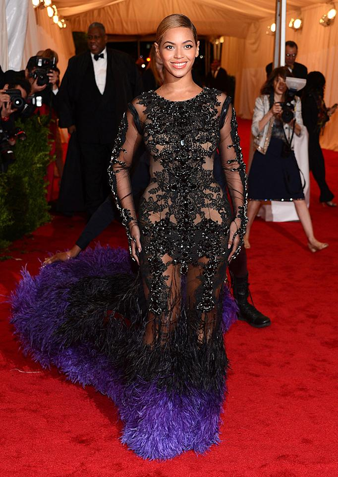 Beyonce was one of the very last celebs to arrive, but she was certainly worth the wait! The new mom strutted her stuff in an elaborate Givenchy creation, featuring intricate beading and black-and-purple feathers. What do you think her of her Vegas-like look?