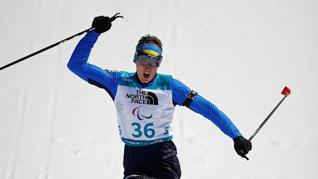 Biathlon - Pyeongchang 2018 Winter Paralympics - Men's 12.5km - Sitting - Alpensia Biathlon Centre - Pyeongchang, South Korea - March 13, 2018 - Taras Rad of Ukraine celebrates winning the gold. REUTERS/Carl Recine