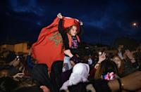 A girl waves the Moroccan flag during protests on February 19 against the closure of the border with the Spanish enclave of Ceuta