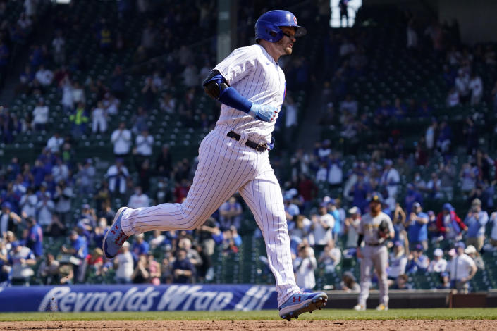 Chicago Cubs' Ian Happ rounds the bases after hitting a solo home run during the third inning of a baseball game against the Pittsburgh Pirates in Chicago, Sunday, April 4, 2021. (AP Photo/Nam Y. Huh)