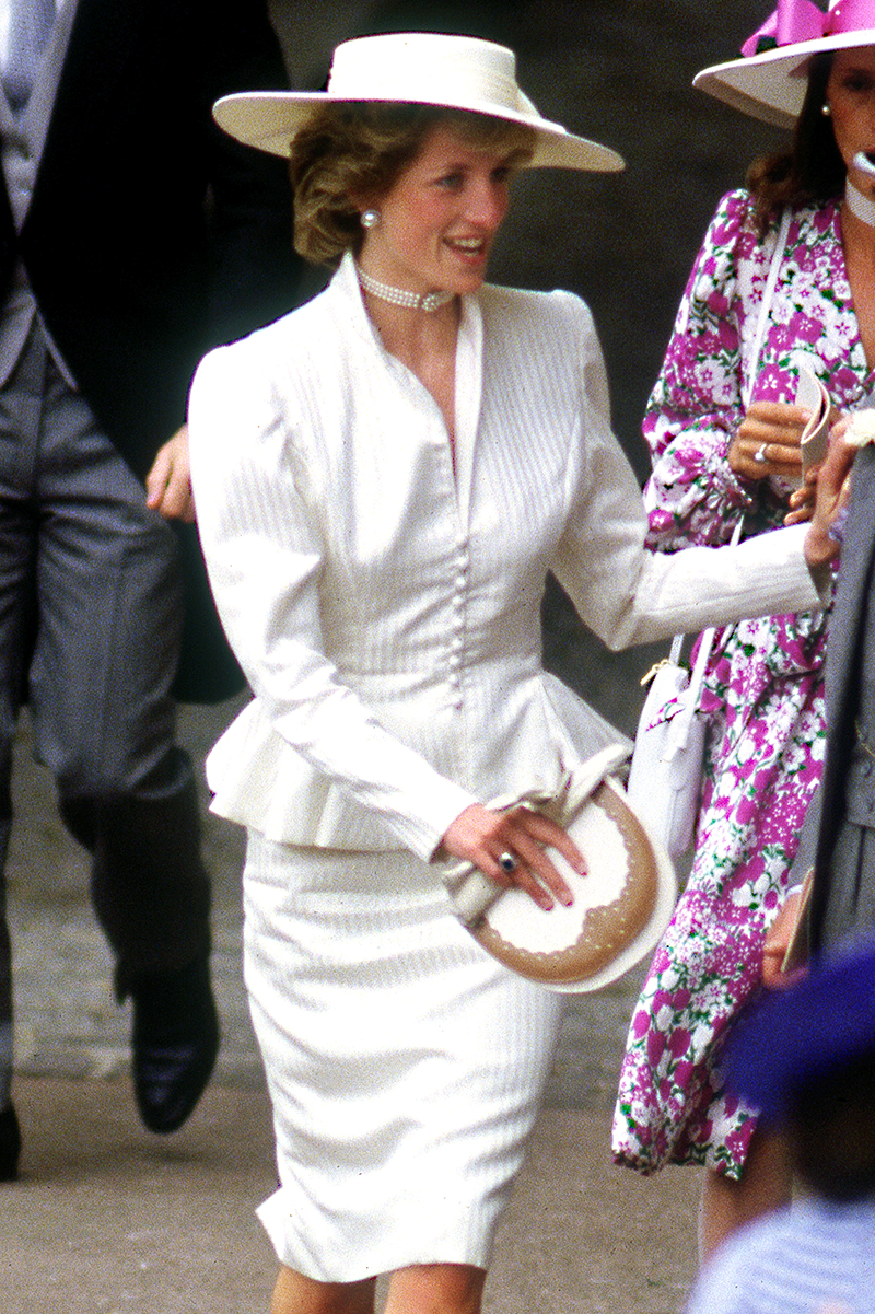 <p>Diana looks like a character from a classic novel wearing this white pinstripe peplum look with a mega-chic hat at Royal Ascot in June 1986.</p>