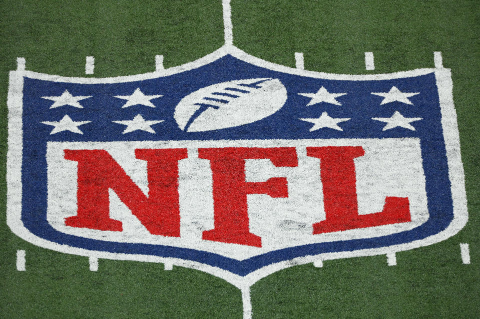 """FILE - This Monday, Nov. 2, 2020 file photo shows the NFL logo at a stadium in East Rutherford, N.J. Thousands of retired Black professional football players, their families and supporters are demanding an end to the controversial use of """"race-norming"""" to determine which players are eligible for payouts in the NFL's $1 billion settlement of brain injury claims, a system experts say is discriminatory. (AP Photo/Adam Hunger, File)"""