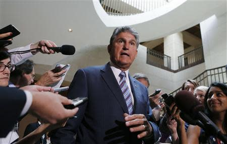 Manchin departs after a classified intelligence briefing with members of Congress on Syria in Washington