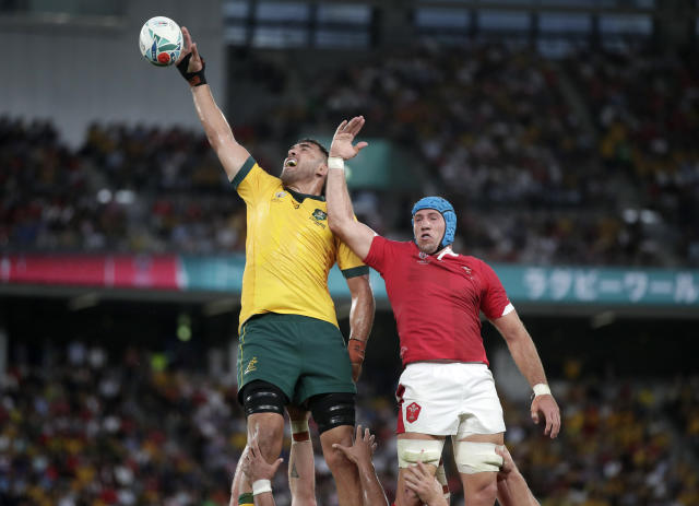 Australia's Rory Arnold, left, leaps above Wales Justin Tipuric to win lineout ball during the Rugby World Cup Pool D game at Tokyo Stadium between Australia and Wales in Tokyo, Japan, Sunday, Sept. 29, 2019. (AP Photo/Jae Hong)
