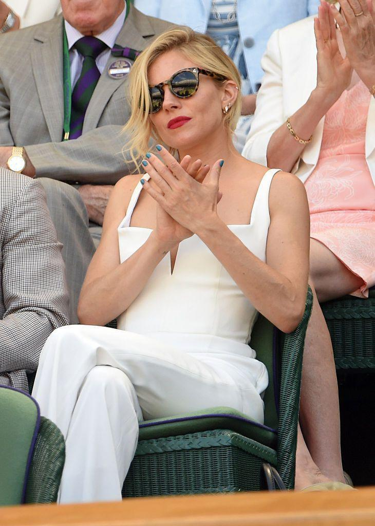 <p>Miller wore a white jumpsuit. </p>