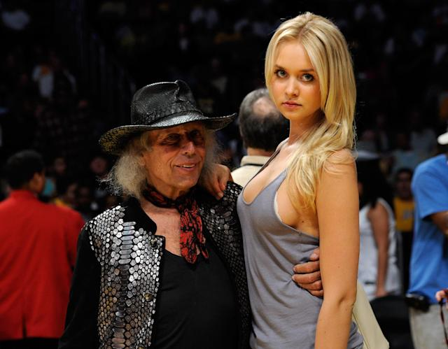 <p>Amalie Wichmann poses with James Goldstein during the 2011 NBA Playoffs in 2011. </p>