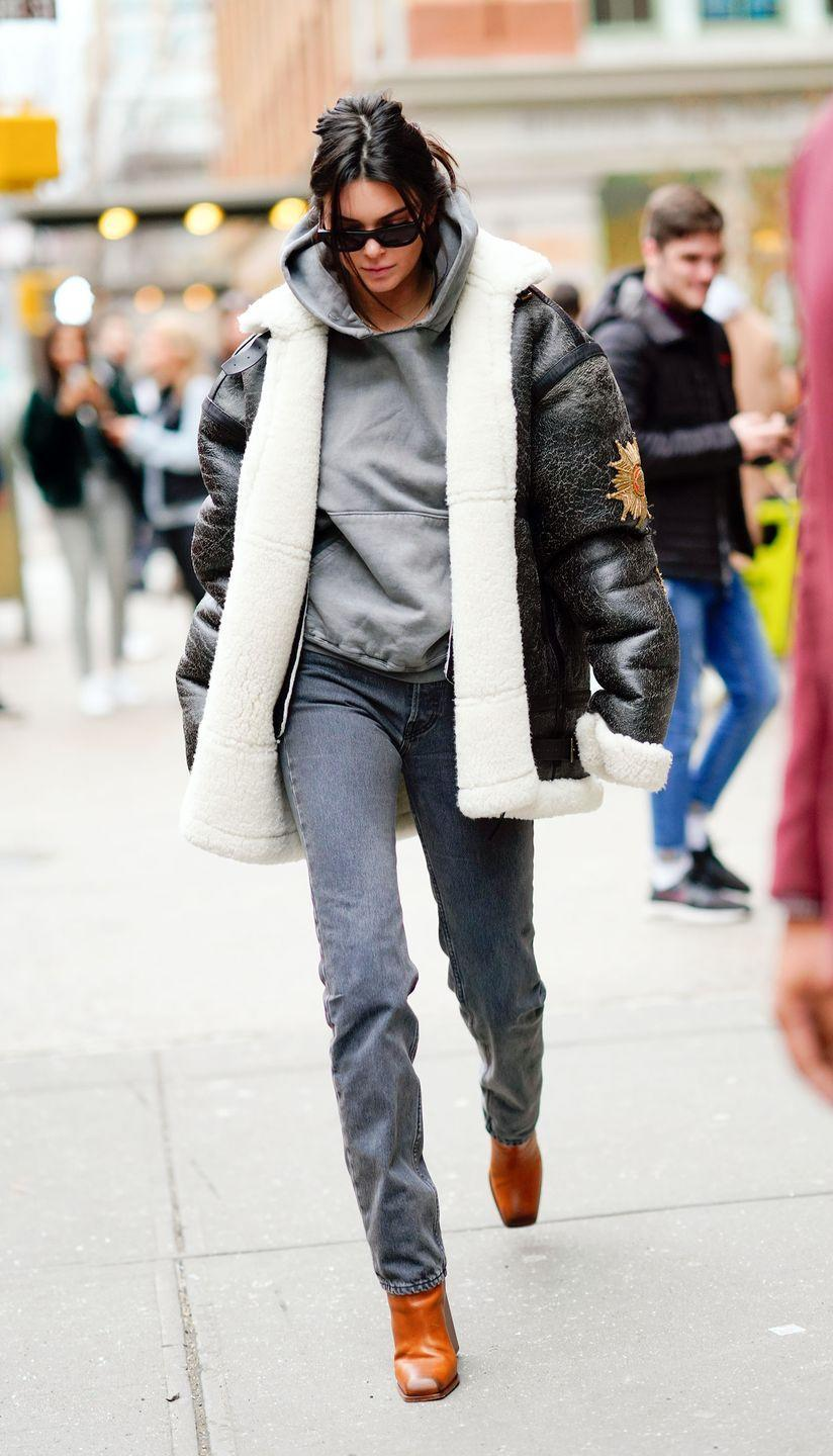 <p>Kendall sported tan-hued leather boots, grey jogging bottoms, a hoodie and a black aviator coat for a day out in NYC, January 2018</p>