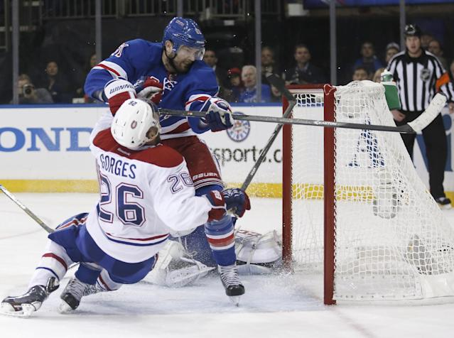 New York Rangers left wing Rick Nash (61) collides with Montreal Canadiens defenseman Josh Gorges (26) in front of the Canadiens goal during the second period of Game 3 of the NHL hockey Stanley Cup playoffs Eastern Conference finals, Thursday, May 22, 2014, in New York. (AP Photo/Kathy Willens)