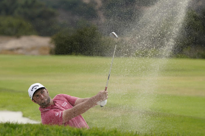 Jon Rahm, of Spain, hits from the sand trap on the 17th fairway during the final round of the U.S. Open Golf Championship, Sunday, June 20, 2021, at Torrey Pines Golf Course in San Diego. (AP Photo/Marcio Jose Sanchez)