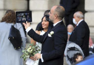A newly married couple join a zoom call after getting married ahead of a national lockdown for England starting Thursday, in Nottingham City Centre, England, Wednesday, Nov. 4, 2020. (Mike Egerton/PA via AP)