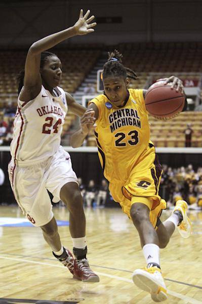 Central Michigan's Crystal Bradford, right, drives to the basket against Oklahoma's Sharane Campbell during the first half of a first-round game in the women's NCAA college basketball tournament Saturday, March 23, 2013, in Columbus, Ohio. (AP Photo/Jay LaPrete)