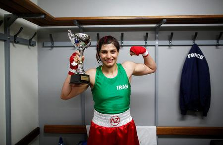 Iranian boxer Sadaf Khadem poses in the locker room after winning the fight against french boxer Anne Chauvin during an official boxing bout in Royan