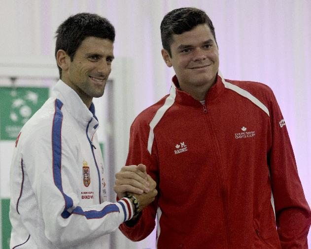 Novak Djokovic of Serbia, left, and Milos Raonic of Canada pose for a photograph during the Davis Cup semifinals draw ceremony in Belgrade, Serbia, Thursday, Sept. 12, 2013. Serbia will face Canada in the 2013 Davis Cup semifinal that starts on Friday, Sept. 13 in Belgrade. (AP Photo/ Marko Drobnjakovic)