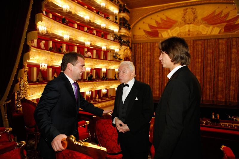 FILE - In this Friday, Nov. 18, 2011 file photo, then, Russian President Dmitry Medvedev, left, speaks with choreographer Yuri Grigorovich, center, and Bolshoi ballet art director Sergei Filin as he attends the premiere of Sleeping Beauty in the Bolshoi Theater in Moscow, Russia. Filin was attacked Thursday night, Jan. 17, 2013, by an unknown person who splashed acid onto his face. (AP Photo/RIA Novosti, Dmitry Astakhov, Presidential Press Service, File )