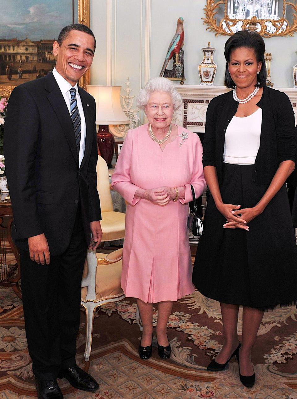 <p>Her Majesty chose a cheerful pink dress for an audience with President Barack Obama and First Lady Michelle Obama at Buckingham Palace on April 1, 2009.</p>